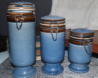 Set of 3 blue stoneware canisters with metal clasp lids.  Made in Italy.