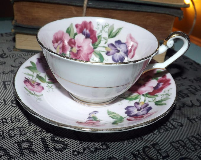 Mid-century Windsor Bone China 387 cup and saucer set made in England.  Pink, purple flowers, pink ground, gold edge accents.