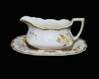 Art deco vintage (1930s) Myott Sunshine Susie gravy boat with matching oval under-plate made in England. Flaw (see below).