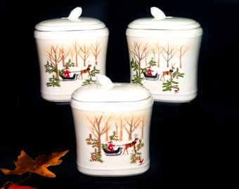 Set of three vintage Hallmark Cards Christmas canisters. Santa and his reindeer-driven sleigh, winter scene. Holiday decor.