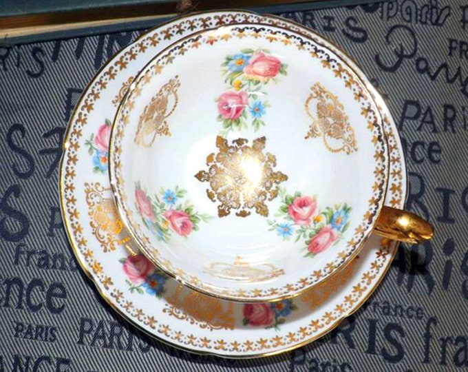 Vintage (1960s) Royal Grafton 8651 hand-decorated tea set (footed cup with and saucer). Abundant gold, roses. Medallion center