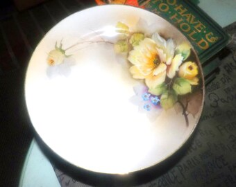 Almost antique (1920s) Nippon | Noritake | Morimura hand-painted salad or side plate. Yellow roses, blue flowers, lilac ground, gold edge.