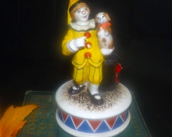 Schmid Japan The Entertainer Clown and Dog hand-painted porcelain music box No. 254. Original label affixed to base.