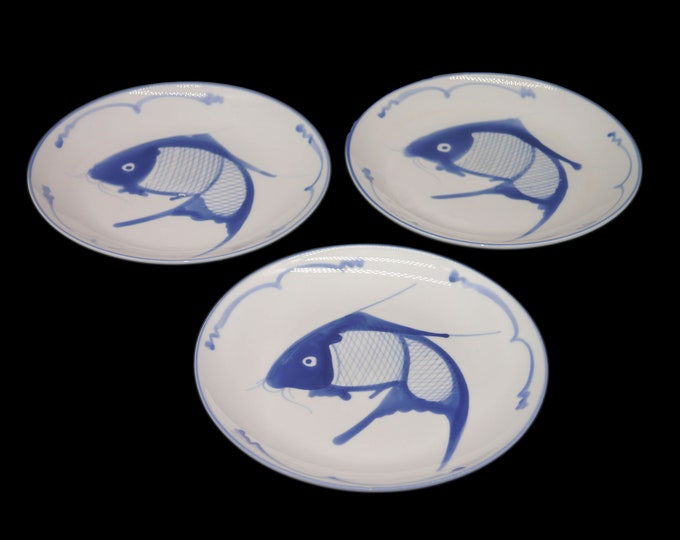 Set of three vintage (1960s) Chinese blue-and-white koi fish luncheon plates. Charming for seafood night or nautical home decor.