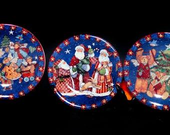 Set of three vintage (1990s) Susan Winget Certified International Christmas Magic salad plates.