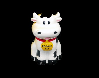 Vintage (1992) Fun Damental Too Mooing Cow cookie jar. Cow goes moo when lid is opened. Battery operated.