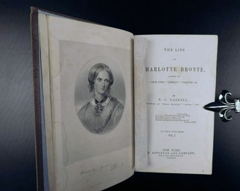 Pair of antiquarian Victorian-era (1887) first-edition books The Life of Charlotte Bronte by fellow author Elizabeth Gaskell in two volumes.