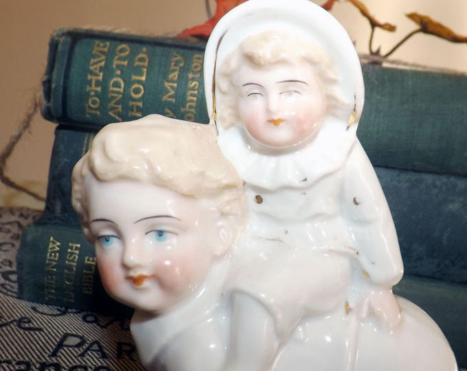Antique Victorian era porcelain piano baby attributed to German manufacture likely either Heubach, Hertwig or Shafer. Hand-painted.