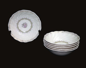 Vintage (1960s) Sovereign Potters Fidelity coupe cereal bowl. English ironstone decorated in Canada. Sold individually.