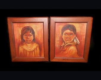 Pair of Native American Children original oil on canvas paintings by artist Cindy Mac D. Wood frames. Signed bottom right.