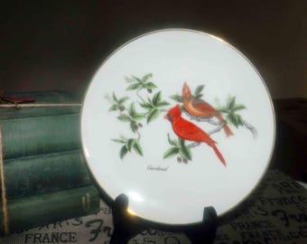 Vintage (1986) John James Audubon Porcelains decorative plate. Pair of Cardinals, olive branch gold trim. Made in Japan.