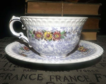 Almost antique (1920s) George Jones   Crescent Pottery The Windsor hand-painted cup and saucer set made in England. Sets sold individually.