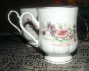 Vintage (1980s) Crown Ceramics India bone china footed coffee   tea mug. Pink and purple flowers, scalloped gold edge, accents.