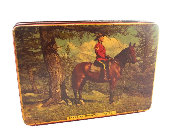 Mid century Rileys English Toffees tin. Canadian Mountie on Patrol. Hinged lid. Made in England.