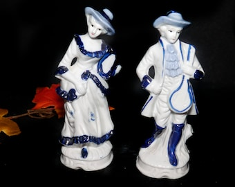 Pair of mid-century Dresden-like figurines. Courting Couple man and woman in period Victorian dress. Attributed Taiwan 1950s to 1960.