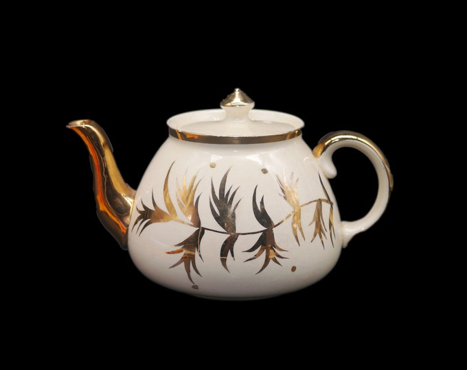 Mid century Gibson England T720 four-cup teapot with lid. Golden leaves plumes dots made in England. Minor flaw (see below).