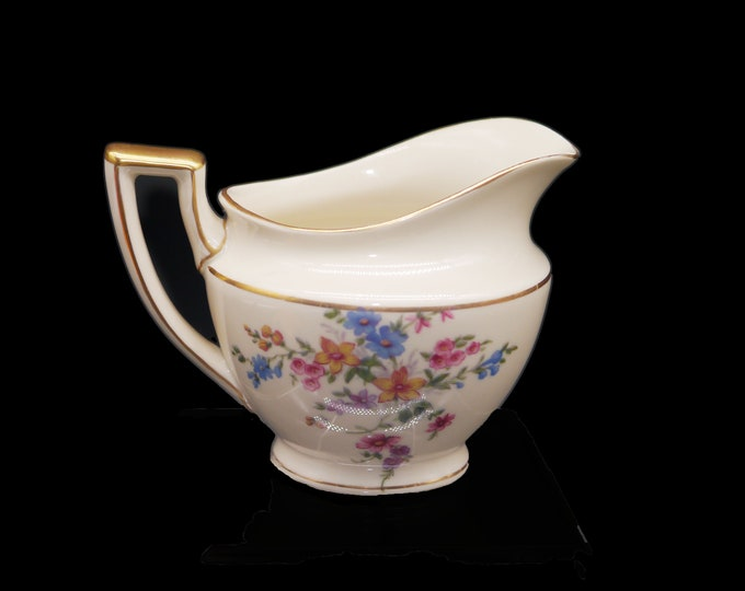 Mid century Heinrich & Co HC705 creamer or milk jug. Blue daisies with pink and yellow flowers, gold edge accents. Made in Bavaria.