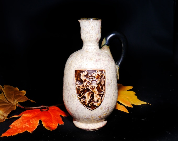 Mid-century Sylvain Sttublet handled art pottery stoneware jug with high-relief Bavarian crest. Made in Belgium.
