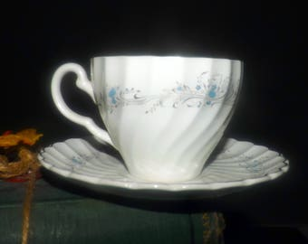 Vintage (1960s) Sovereign Potters Charmian R110-62 cup and saucer set. English ironstone decorated in Canada. Sold individually.