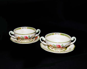 Pair of antique (1920s) Wedgwood Rodney hand-painted cream soup sets made in England.