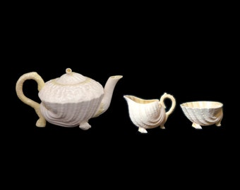 Vintage (1960s) Belleek Neptune Yellow teapot with lid or creamer and sugar bowl set made in Ireland. Belleek green mark. Sold individually.