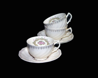Vintage (1960s) Sovereign Potters Fidelity cup and saucer set. English ironstone decorated in Canada. Sets sold individually.