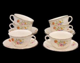 Pair of vintage (1930s) Alfred Meakin Dronfield cup and saucer sets made in England. Sets sold in pairs only.