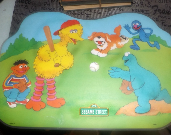 Vintage (1982) Sesame Street Big Bird child | baby | toddler plastic placemat. Big Bird and pals playing baseball, games, puzzles reverse.