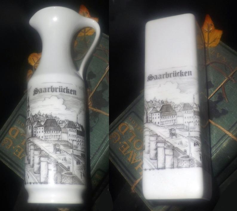 Pair of vintage (1960s) KPM Kerafina Royal Porzellan pieces of vinegar or  oil jug and vase  Hand-painted  Ludwigskirche, Saarbrucken