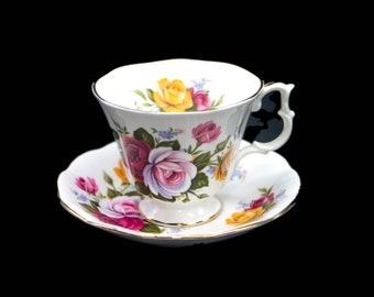 Vintage (1970s) Royal Albert cup and saucer set made in England. Pink, red, yellow roses.