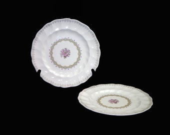 Vintage (1960s) Sovereign Potters Fidelity small dinner or luncheon plate. English ironstone decorated in Canada. Sold individually.