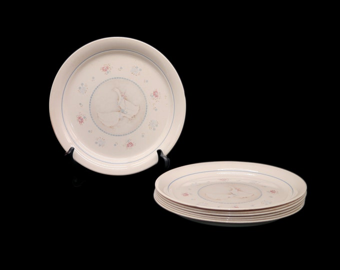 Set of seven vintage (1980s) Corelle Corningware Country Promenade dinner plates made in the USA. Geese with bows. Flaws (see below).