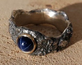 Star sapphire, gold and rough silver ring