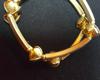 Brass bracelets with glass beads
