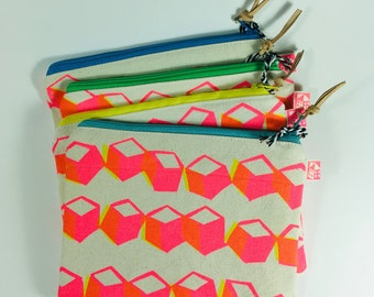 Hand printed bag, screen printed geometric cube pattern, could use as make up bag, zip pouch, mask bag