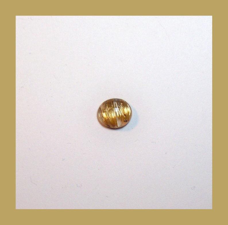 CATSEYE RUTILATED QUARTZ  Cabochon \u2013 Unique Rolling Broad Flash Effect \u2013 10 x 8 Millimeter Oval \u2013 Made In Maine