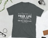 If you measure your life by what you own, the cavern of your heart will never be filled Short-Sleeve T-Shirt Christian bible verse t-shirt