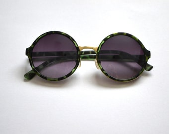 vintage green and gold frame sunglasses with black lens and