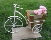 Shabby white metal tricycle stand for flowers, Vintage metal tricycle and a wooden flower pot, White metal tricycle, Retro tricycle