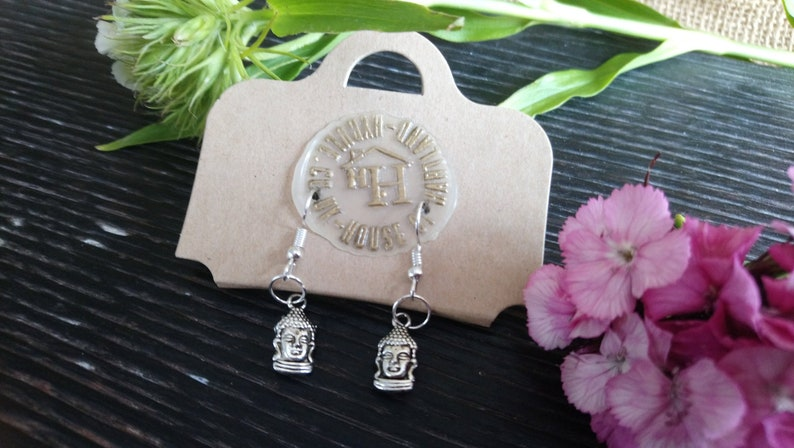 Pretty little Bhudda silver plated drop style earrings  image 0