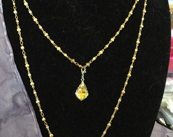 Necklace.  Double strand of gold toned chains displaying Swarovski crystals! This piece looks like something straight from the RED CARPET!