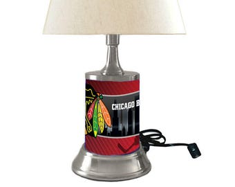 Table Lamp with shade, Chicago Blackhawks plate rolled in on the lamp base