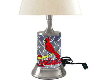 Table Lamp with shade, St. Louis Cardinals plate rolled in on the lamp base, base wrapped diamond metal plate