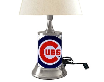 Table Lamp with shade, Chicago Cubs plate rolled in on the lamp base, the base wrapped with diamond metal plate