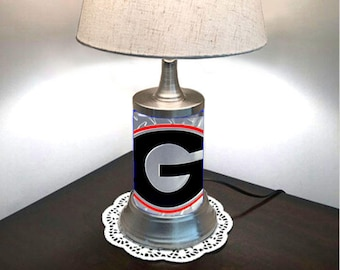 Table Lamp with shade, Georgia Bulldogs plate rolled in on the lamp base, base wrapped with diamond metal plate