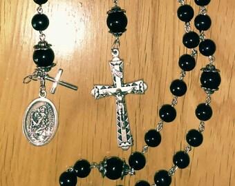 Black rosary & steering wheel rosary
