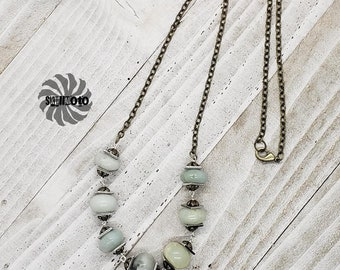 Amazonite wire wrapped necklace with silver and bronze spacers