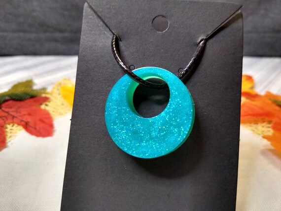 Blue glitter pendant necklace epoxy resin on black 20 inch cable chain