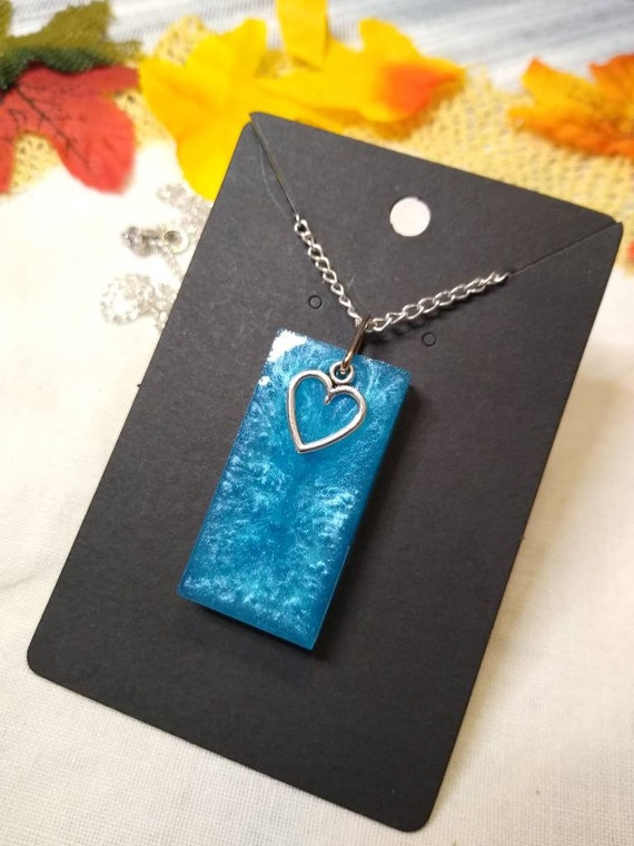 Blue shimmery pendant necklace with heart charm epoxy resin on black 20 inch silver plated metal chain