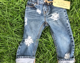 02c7135bd74 Distressed jeans for babies and toddlers